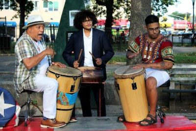 Jose L. Ortiz of Bomba Yo and his drummers lay down the beat for the dancing crowd.