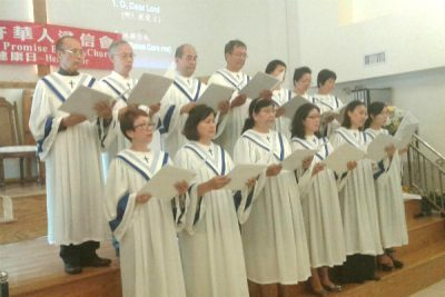 The Chinese Promise Baptist Church Choir sings for the attendees.