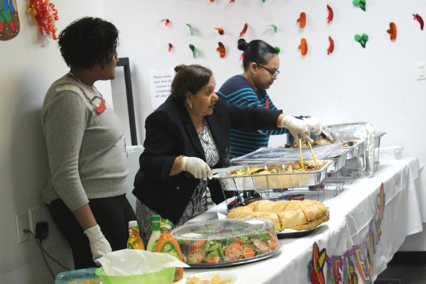 Dennelisse LHCSA employees get ready to feed our new friends at the open house.
