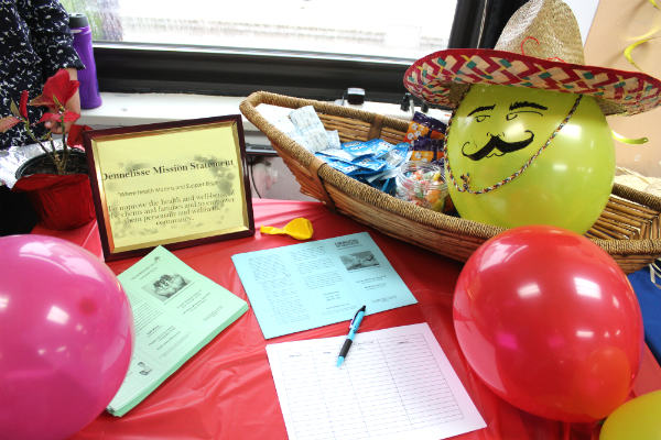 A decorated table full of information for Dennelisse LHCSA and LWS Homecare's guests to bring home.